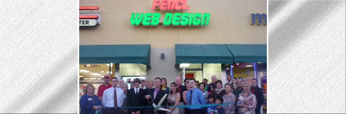 Official opening of Fencl Web Design with oversized scissors to cut the tape